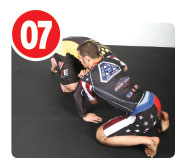 When his opponent hits the mat he's forced to at least post  with one hand to the mat or else he's going to smash his head. When he does this it opens up the opportunity for the guillotine.
